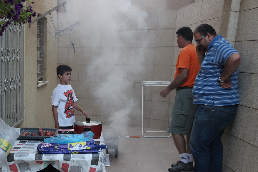 Fouad, Zaher and Ronnie barbequing the meat