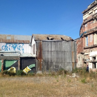 More street art and brick building frames being held up