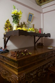 Every house has an antire room for a pagoda, with offerings of all kinds. There's a photo of their dead grandfather.
